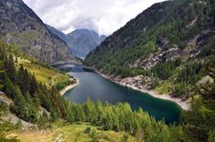 Alpine lake hydroelectric basin - Lake Campliccioli in the Italian Alps with dam, hydroelectric basin used for renewable energy generation purposes, Valle Antrona, Italy