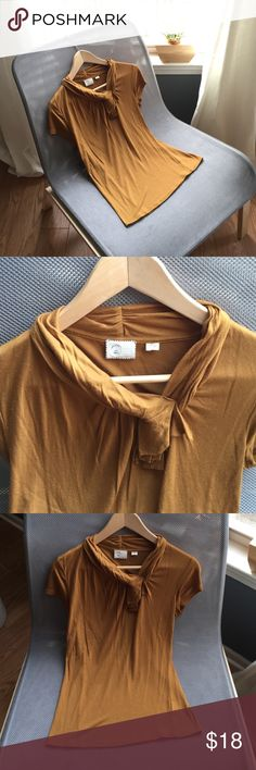 Anthropologie Postage Stamp Top 100% modal, mustard colored. Ruffled fabric along neckline. 34 inch bust, 24 inches in length. Fits TTS. Excellent condition. Anthropologie Tops