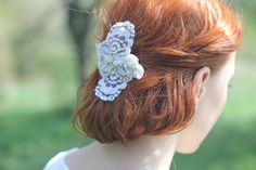 This bridal hair comb features beautiful flowers which I hand cut from a vintage lace from 1970s in a wonderful condition. It was kept safe in one of