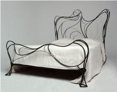 "...and wrought iron beds also come in ""zany organic."""