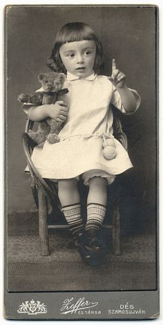 Antique Photo of an Adorable Child with a Teddy Bear