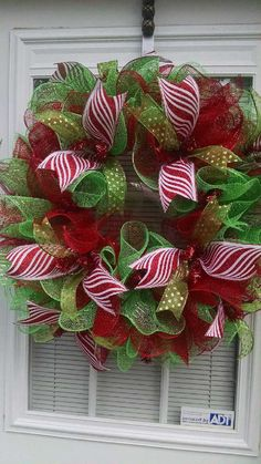 Christmas is around the corner. This Beautiful Christmas wreath would look wonderful on your front door. it is made with red and green deco Wreath Crafts, Diy Wreath, Christmas Projects, Christmas Crafts, Christmas Decorations, Christmas Ornaments, Holiday Decor, Tulle Wreath, Half Christmas