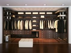 Fancy - Walk-In Wardrobe by Wackenhut - use stained Lowes Wood panels for the back and for covering the shelves