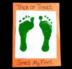 "Add green footprints to a white sheet of paper with the title ""Trick or Treat, Smell My Feet""."