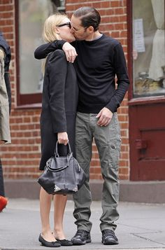 Strangers? Who cares! Beauty Kate Bosworth and beau Michael Polish give in to the urge to kiss on the NYC streets on June 5, 2012.