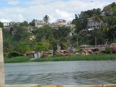 Santo Domingo, Dominican Republic~ A squatters village along the Ozama River. When Hurricanes approach these villages are wiped out. An Episcopal Church was built up on a hill to give these people a place to evacuate in the event of a bad storm.