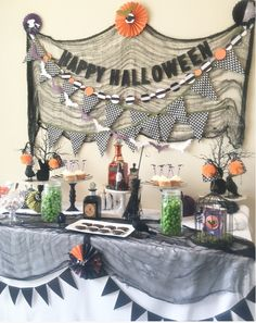 Happy Halloween candy and dessert table! Perfect for any children party or adult Halloween party. Halloween party decorations available on Etsy.