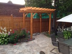 A sandwiched style fence called the Sandringham with alternating boards to add character topped with a horizontal/vertical lattice.  The homeshow pergola stands tall and proud taking centre stage.Stained with Sansin stain all available at Lanark Cedar.