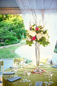 Head table flowers in silver fluted vase.