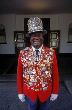 Doorman at Victoria Falls Hotel: Online I have seen images of the doorman/men at the Victoria Falls Hotel.  Their jackets are 'decorated' with numerous buttons or badges.   What are those