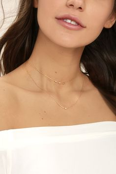 "There's no wrong way to wear the Finer Things in Life Gold Layered Choker Necklace! Two layers of dainty gold chain, embellished with tiny sparkling rhinestones. Shortest layer measures 12"" with a 2"" extender chain."