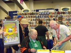 Gary Arlington in wheel chair with Robert Beerbohm in his booth, San Francisco's last Wondercon at Moscone Center 2011