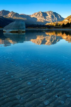 Mountain reflections in the Sierra Nevada at June Lake, California Get this as a metal print!