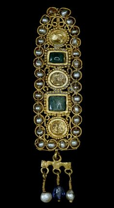 Gold hair ornament, set with natural pearls, emeralds and sapphires. Roman. 3rd Century AD. From -- Pearls: About the Exhibition - Victoria and Albert Museum