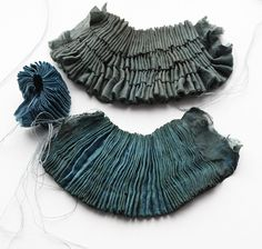 Fine dimensional pleat detail - blue & green sea inspired fabric manipulation samples, developed into jewellery #textiles