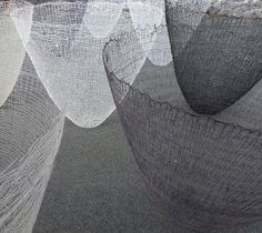 Gjertrud Hals (giant knitted vases : these 'Ultima' vessels are combinations knitted cotton, linnen threads and resin casts)