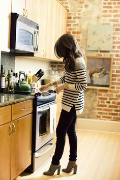 black skinny jeans; grey, black, and white striped sweater / tunic