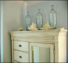 Just a touch of the beach with shells and blue colored glass bottles