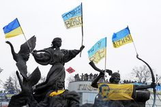Ukrainian protest flags attached to a statue