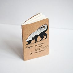 Need a daily affirmation? Must-have honey badger notebook with wise notations.