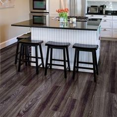 TrafficMaster Allure Ultra 7.5 in. x 47.6 in. Aspen Oak Black Resilient Vinyl Plank Flooring (20 sq. ft./case) | Home Depot  Installs in floating planks like wood and laminate, but it's waterproof! Can be installed in kitchens and bathrooms.