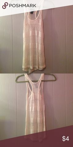 Tank top White tank top. Only worn about once. I see it being used more as a swim suit coverup but would great in anyway you want to style it Wet Seal Tops Tank Tops