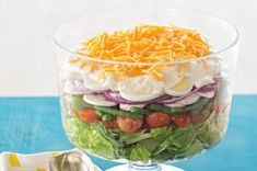Lovely Layered Salad Recipe - Kraft Recipes~cups  each tightly packed torn romaine lettuce and arugula leaves 2 cups  each halved cherry tomatoes, sliced fresh mushrooms and blanched cut fresh green beans 1/2  red onion, thinly sliced, separated into rings 4  hard-cooked eggs, sliced 3/4 cup  KRAFT Mayo with Olive Oil Reduced Fat Mayonnaise 1/4 cup  KRAFT Grated Parmesan Cheese 2 Tbsp.  sugar 1/2 cup  KRAFT 2% Milk Shredded Cheddar Cheese