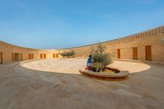 Built using locally sourced hand-carved sandstone, the 836-square-metre fort-like school comprises three circular elements. Contemporary Architecture, Interior Architecture, Interior Design, David Chipperfield Architects, Cladding Materials, Woodland House, Concrete Facade, India School, Dezeen