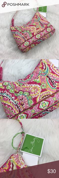 🍎Vera Bradley Pink Paisley Quilted Small Handbag Vera Bradley NWT Pink Paisley Print Quilted Small Handbag  Length: 10 inches  Height: 6 inches  Width: 2 inches  This is new with tags.  This has never been worn. Please refer to photos for more details. Vera Bradley Bags