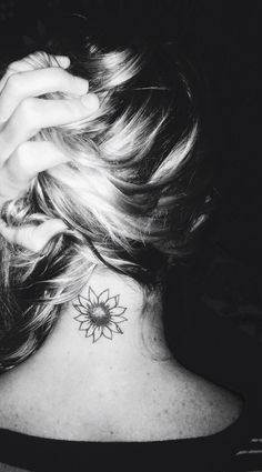 Sunflower neck tattoo.