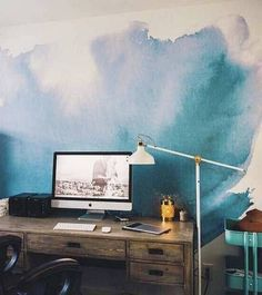 wallpaper design ideas blue watercolor pattern.  Any office space would benefit from this stunning blue wall. We can already feel our productivity increasing, with just one colorful statement.