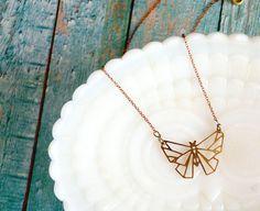 modern brass laser cut geometric moth necklace by mossandmirror
