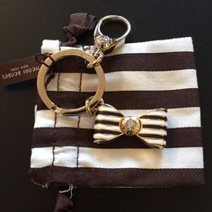 Henri Bendel Bow Key Fob Brand new with tags Henri Bendel bow with Signature brown and white stripes key fob. You can use it as a key chain or accessorize your bag with it. henri bendel Accessories Key & Card Holders