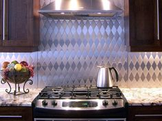 A strong, but not too strong, harlequin pattern consisting of alternating diagonal layers of brushed and polished stainless is frequently paired with flat-panel cherry or oak cabinets. Photo Credit: Stainless Living