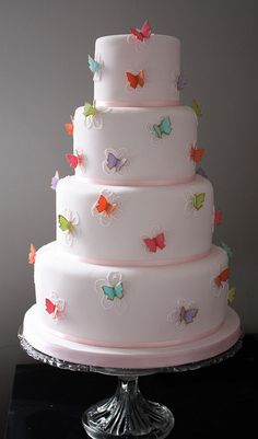simple but beautiful!  multi colored butterfly wedding cake (and I don't even like butterflies!)