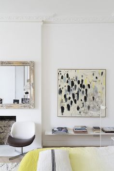 Vintage mirror and modern chair in bedroom. An artist's studio and home, and a location home from JJ Locations, located in Camberwell, England. / Sfgirlbybay