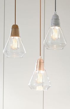 Ando 1 light pendant with cork, copper or concrete lampholder and glass shade.