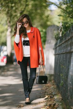 The Londoner wears Boden Charlotte Cape, London cashmere jumper and Audrey Bow Flats.