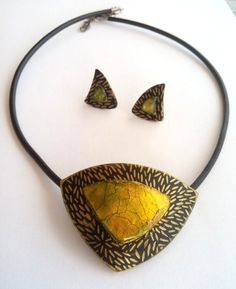 Polymer clay silkscreen and faux dichroic pendant and earrings by Manon van Kempen