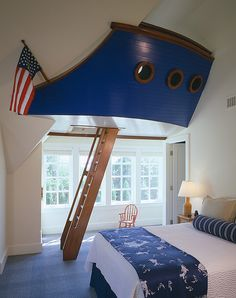 Nautical inspired bedroom with a boat and ladder