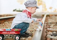 Too  cute for a train lover....3rd Birthday Pics by the train tracks :)