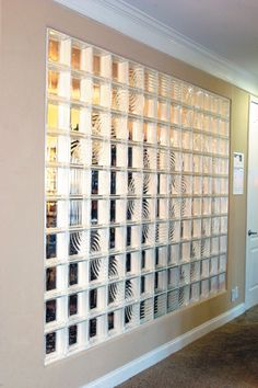 This frameless Glass Block window pre-fabricated or supplied as a Stack & Grout System installs with ease. With the combination of 3 different Pittsburg Corning Glass Block styles, the Vue Block (Clear Glass Block), Spyra Pattern, and the Argus Parallel Fluted Glass Block, this interior partition becomes a wall of light and is a work of art that hold it's own against other masterpieces in the home.