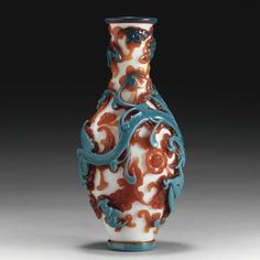 A red and blue overlay glass bottle vase. Qianlong mark, probably of the period. photo courtesy Sotheby's