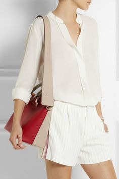 Taupe and crimson leather (Calf) Chain-trimmed two-way zip fastening along top Comes with dust bag