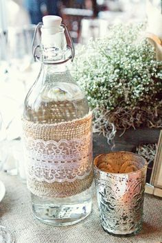 Burlap and lace around bottle. Ticking and Toile: ~burlap, lace & baby's breath tablesetting~ Shabby Chic, Mexican Designs, Burlap Lace, Lace Ribbon, Lace Fabric, Bottles And Jars, Water Bottles, Mason Jars, Glass Bottles