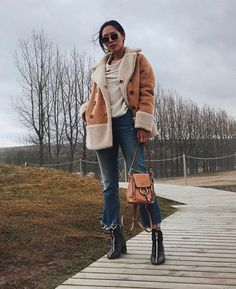Stay warm this winter with a caramel shearling jacket paired with blue denims. Throw on a pair of heeled boots to elevate and refine the look. @songofstyle #MCstyleinspo #OOTD  via MARIE CLAIRE SOUTH AFRICA MAGAZINE OFFICIAL INSTAGRAM - Celebrity  Fashion  Haute Couture  Advertising  Culture  Beauty  Editorial Photography  Magazine Covers  Supermodels  Runway Models