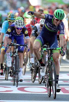 Orica Bikeexchange's Belgian cyclist Jens Keukeleire celebrates winning as he…