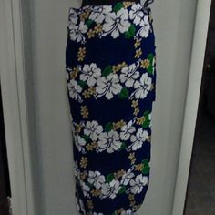 """Vintage Hawaiian wrap skirt Blue, white and yellow floral print  wrap skirt. 100% polyester. No size tag.  Waist measures 46"""" and length is 36"""". Beautiful summer skirt Vintage Skirts"""