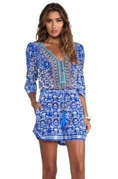 LONG SLEEVE DRAWSTRING WAIST PLAYSUIT CAMILLA Stylist: Love the fun, bold print but I probably wouldnt wear a jumpsuit or maybe I would. I like the print and the colors.