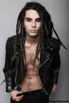 Samuel Larsen  so what that he kinda looks like a dirty hippy/rocker guy that wears eyeliner, he's freaking HOT!!  hehehe